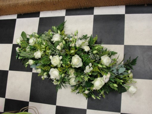 White loose designed double ended casket spray
