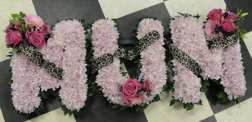 Massed pink xsant mum with leopard print ribbon