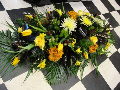 Yellow & brown double ended casket spray