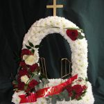 Gates of heaven in red and white with ribbon wording detail