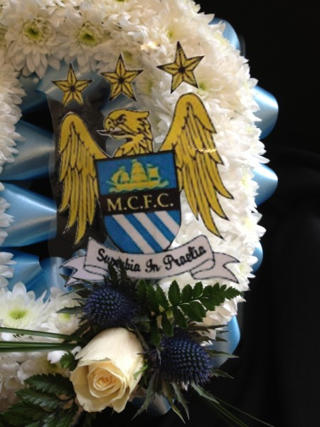 MCFC badge on funeral piece