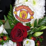 MUFC badge on funeral piece