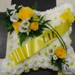 Yellow & white massed cushion with ribbon sash
