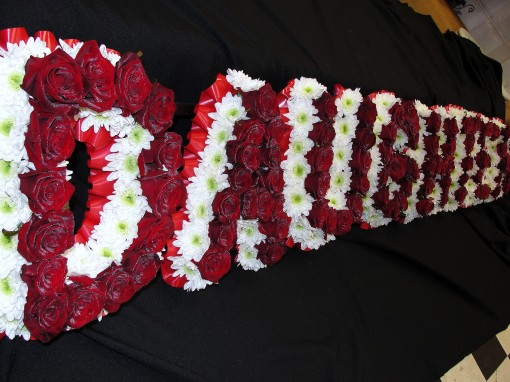 Massed letters with rose overlay