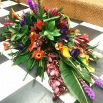 Tropical flowers in a vibrant colour pallet single ended spray